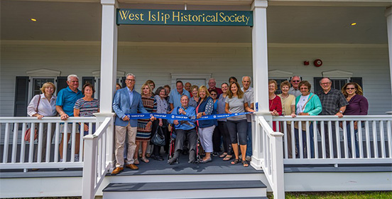 Supervisor Carpenter joins members of the West Islip Historical Society for the ribbon cutting of their new home