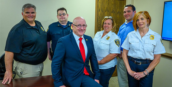 Joe Fox poses with Public Safety Officers at the most recent leadership training course he conducted