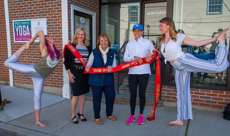 Supervisor Carpenter and Councilwoman Mary Kate Mullen pose with the Sayville Chamber of Commerce and the owners of Free Spirit Yoga outside the new business