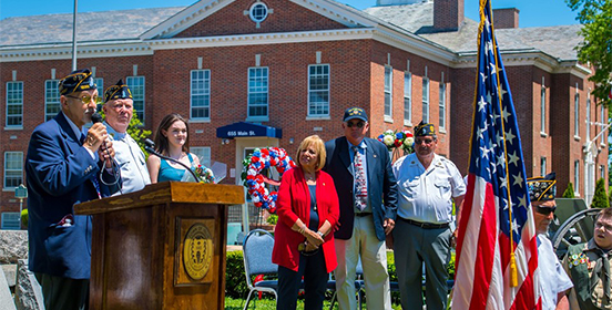 Supervisor Carpenter and Councilman John Cochrane stands with Veterans at a Memorial Day Celebration at Islip Town Hall