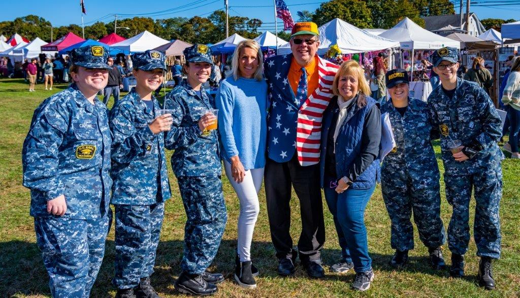 Supervisor Carpenter, Radio Host, Councilwoman Mullen post for a photo with members of the US Naval Sea Cadets.
