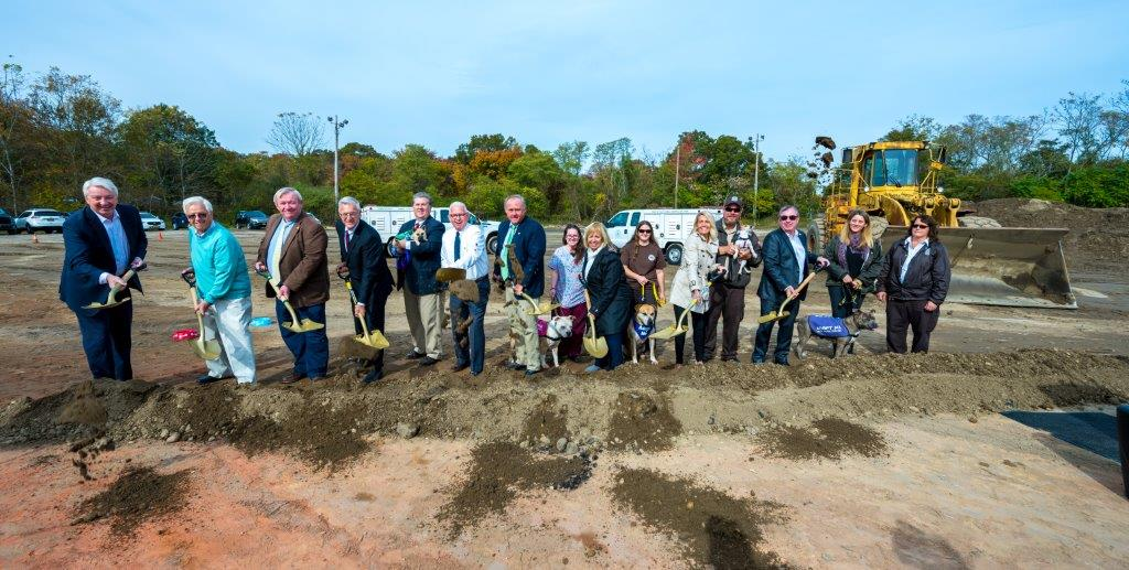 Supervisor Carpenter, Martin Bellew Commissiner of DEC, DEC Staff, and the Islip Town Board and local officials pose for a phot with shovels in their hands, having just broken ground.