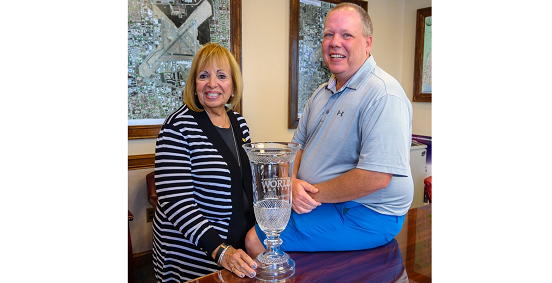 Town Supervisor Angie Carpenter and William Welch pose side by side with trophee.
