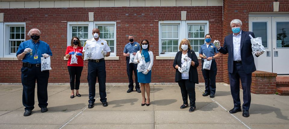 Local Officials stand outside Riverheard Jail with made PPE