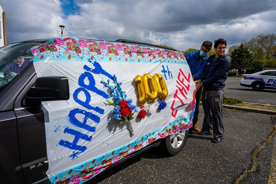 Van decorated top to bottom with Happy 100th Birthday Ethel Sign