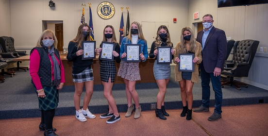 Five students hold certificates of honor given to them by Supervisor Carpenter. The girls of Sayville High School were honored for creating food pantries within their community to help those suffering with food insecurities