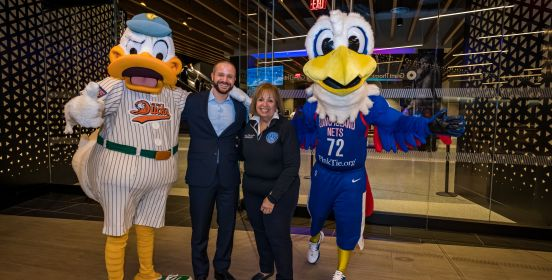 Islip Supervisor Carpenter poses for a photo with Nets representative and mascot as well as Ducks Mascot QuackerJack.