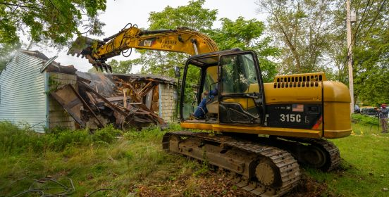 bulldozer tears down structure