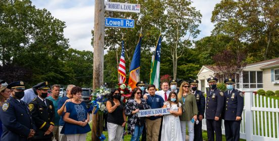the family of Robert Zane Jr. poses with new street sign