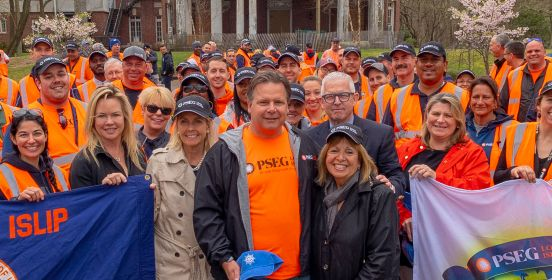 Supervisor Carpenter, Councilwomen Mullen and Bergin along with DPW and Parks Commissioner Owens pose with PSEG Staff and Volunteers on the beautiful grounds of Brookwood Hall holding Town of Islip and Earth Day 2019 flags