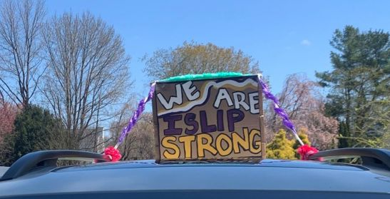 Sign ontop of car says we are islip strong