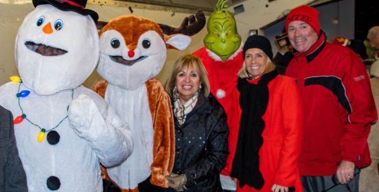 Islip Supervisor Angie Carpenter along with Town Council members Mary Kate Mullen and John P. O'Connor pose with Frosty the Snowman, The Grinch and a Reindeer at the 2019 Islip Holiday Parade and Tree Lighting.