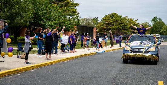 Islip Middle School Staff cheers students and cavalcade.