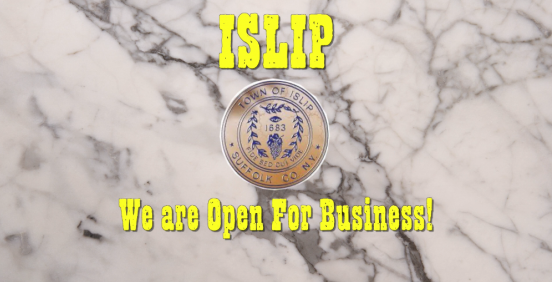 marble background with the words that Islip is open for business