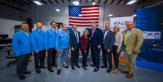 Supervisor Carpenter, Congressman Peter King, Councilmembers Cochrane and Mullen stands with Technology staff for a photo infront of the USA flag.