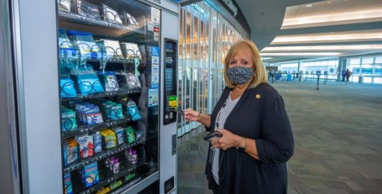 Supervisor tests out new PPE vending machine