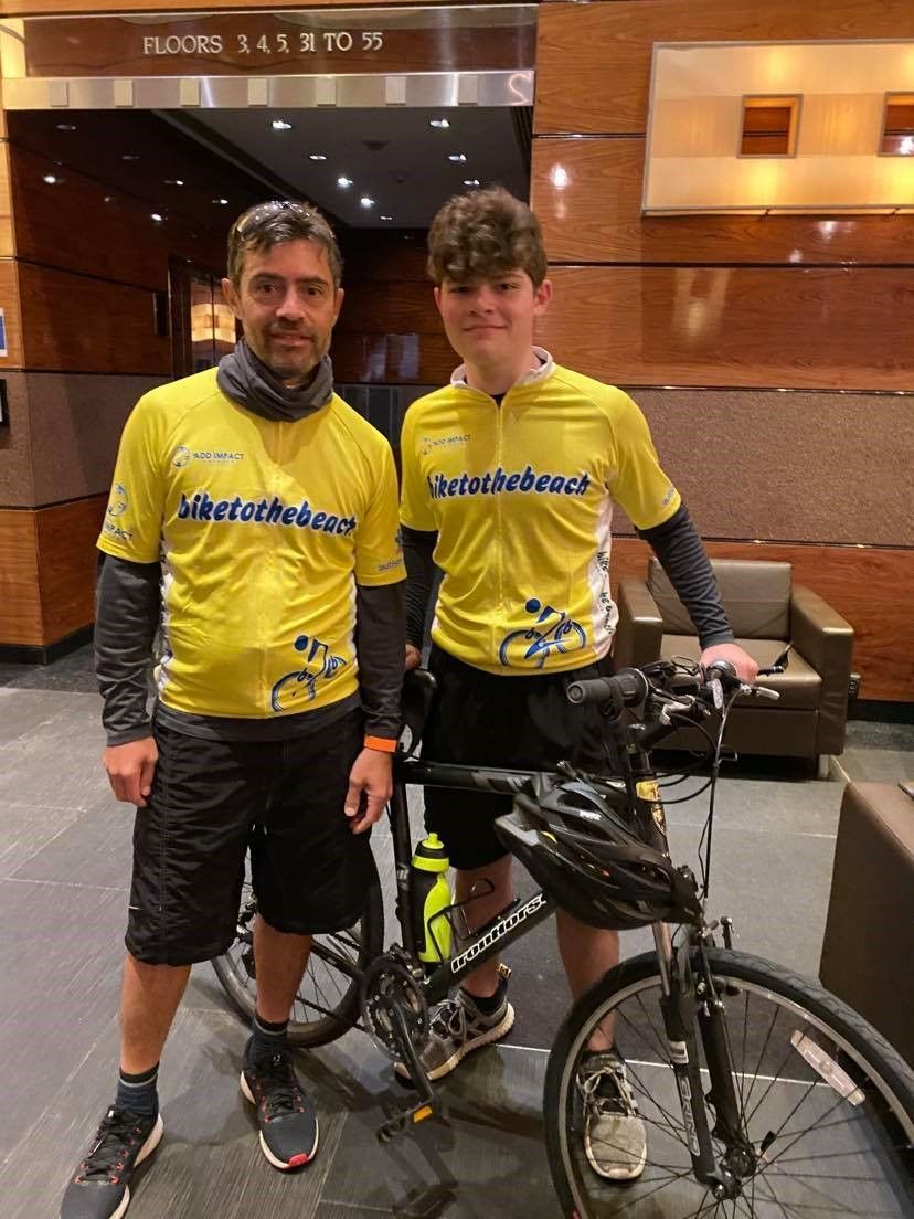 teen cyclist and dad