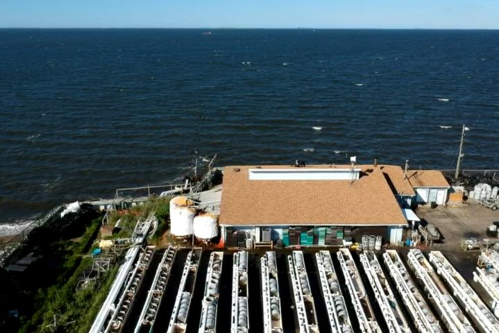 An aerial view of the Shellfish Cultivation Facility, extending right out onto the shore of the Great South Bay.